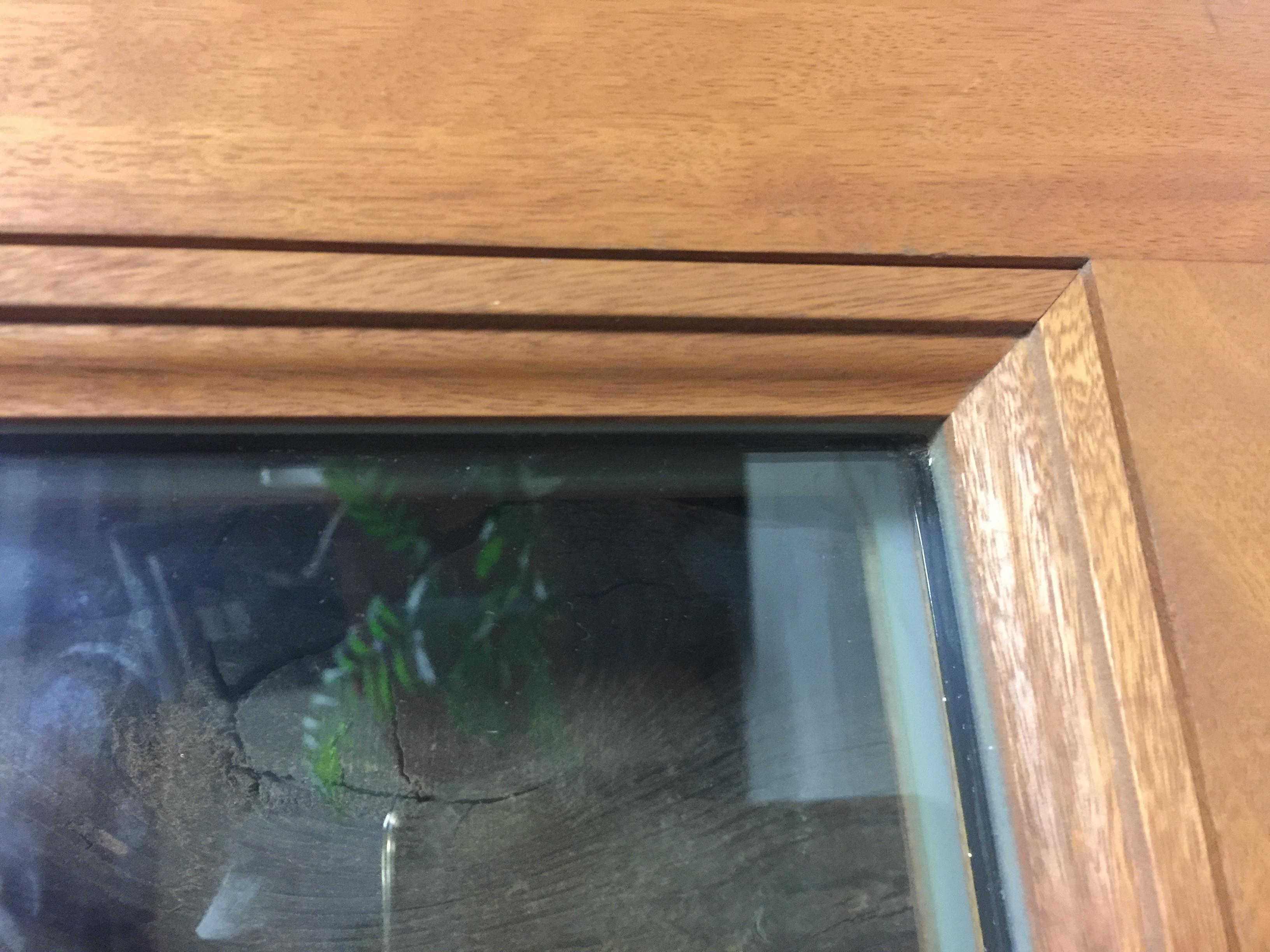 joint de vitrages silicone sur menuiserie bois